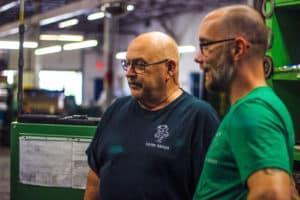 Vortex Metals employees inspecting machine