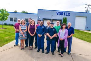 Vortex Metals team standing outside the building