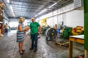 Vortex Metals team members talking in warehouse