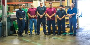 metal worker employees standing in Vortex Metals warehouse