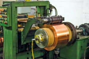 copper metal being rolled