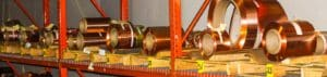 Rolls of copper metal on shelves