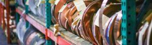 rolls of copper on warehouse shelf